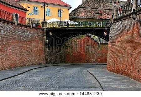 SIBIU ROMANIA - MAY 4: Liars bridge in the street of Sibiu old town on May 4 2016. Sibiu is the city located in Transylvania region of Romania.