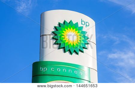 NOVGOROD REGION RUSSIA - JULY 31 2016: BP - British Petroleum petrol station logo against blue sky. British Petroleum is a British multinational oil and gas company