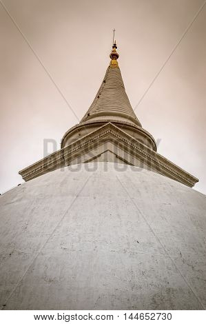 Sri lankan buddist temple with dusty background.
