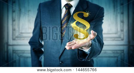 Male corporate attorney offering a golden section sign hovering above his open palm of hand. Business concept for justice system legal representation court proceedings compliance and consultancy.