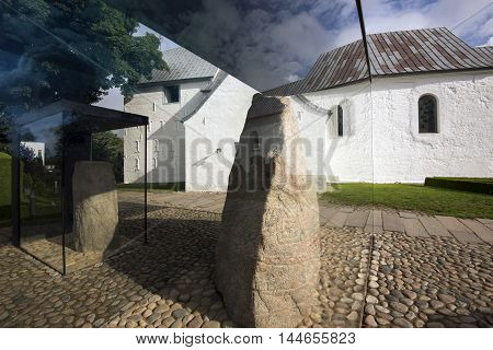 JELLING DENMARK - AUGUST 22 2016: Harald Bluetooth's big Rune Stone and King Gorm's small Rune Stone - The Jelling Monuments are a UNESCO World Heritage Site. August 22 2016