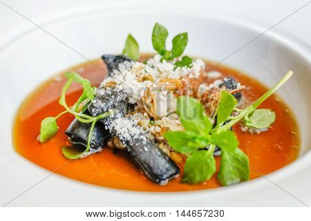 Sauteed Royal Trumpet Mushroom manila clams bonito flakes and herbs on white bowl