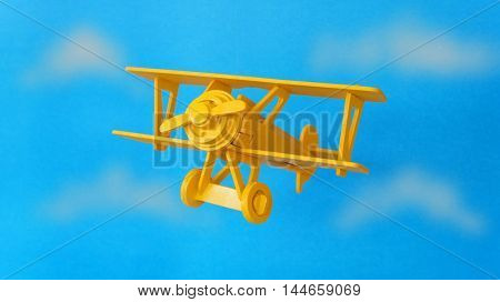 Wooden biplane isolated on blue background