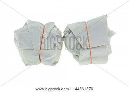 Takeout Thai Food wrapped in white paper package with red rubber band for takeaway, isolated on white background