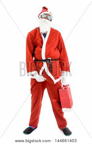 African American Black Thug Gangster Criminal Robber Santa in red costume suit is holding a present bag.