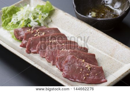Beef heart stabbing Salt with wasabi and Ginger soy sauce on platter