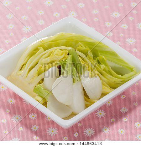 Sauteed white radish with cabbage on white platter
