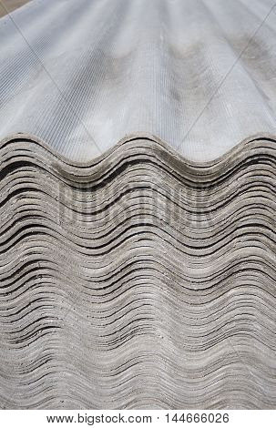 Pack sheets of asbestos slate. Building material for roofing