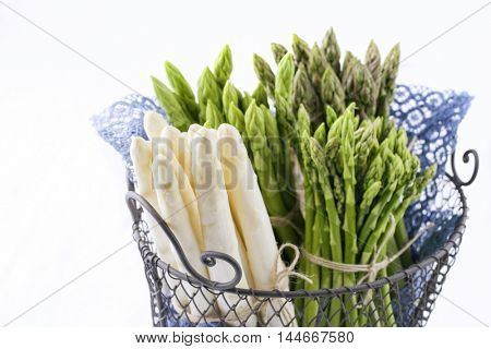 Green and White Asparagus in Basket - isolated