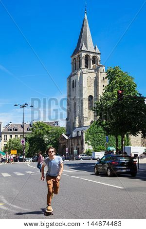 Paris France - Jule 09 2016: Benedictine Abbey of Saint-Germain-des-Pres was the burial place of Merovingian kings one of the oldest churches in Paris. The Abbey was founded in the 6th century. The area around the abbey is also part of the Latin Quarter.