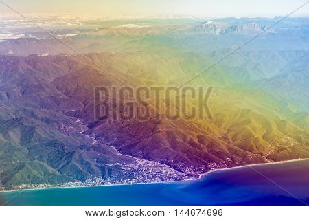 Airplane flying sky over Black sea and Caucasus mountains. View of sky from aircraft long distance travel by airtransport. Russia, Krasnodar Krai, Lazarevskaya