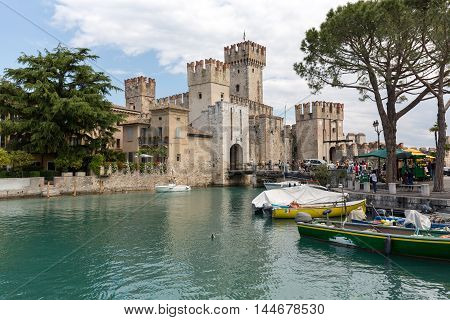 SIRMIONE ITALY - MAY 5 2016: Sirmione - Italian small city on Garda lake with boats and castle