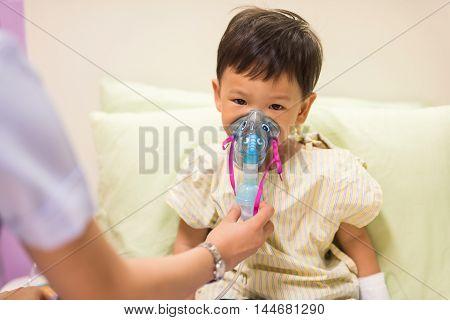 Boy Inhale Medication By Mask