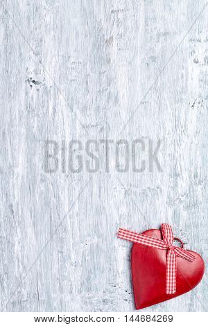 Heart decoration at right bottom corner of  light blue wooden background. Concept of Valentine's day.