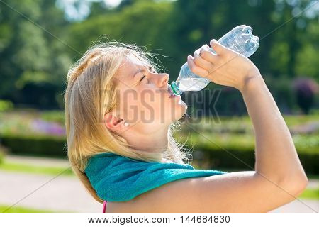 Thirsty Young Woman Finishing Water From Bottle