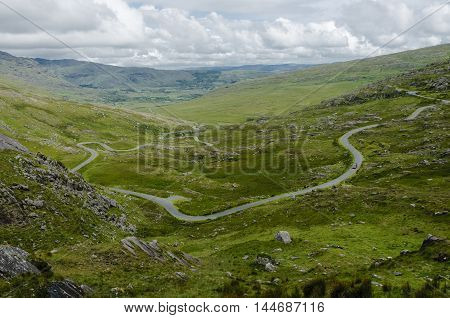 The winding road leading to the Healy Pass between Country Cork and Country Kerry Ireland Europe