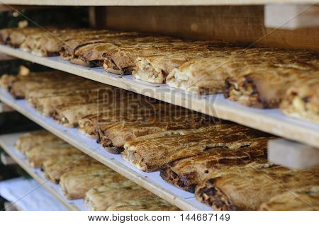 Racks full of traditional strudel in a bakery