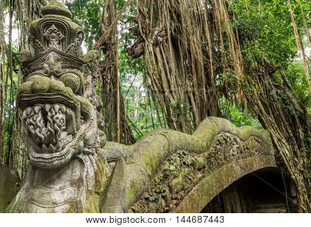 Dragon sculpture on the bridge in monkey forest Ubud Bali.