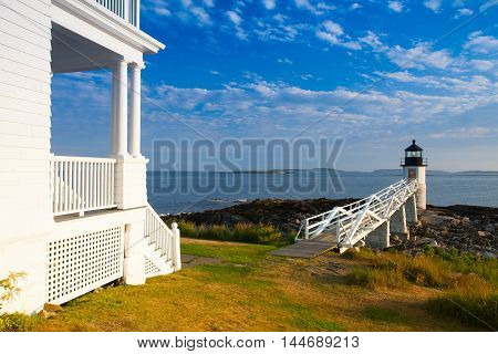 Marshall Point Light as seen from the rocky coast of Port Clyde Maine.