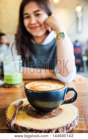 Young Asian Girl Drinking Coffee In Hipster Cafe