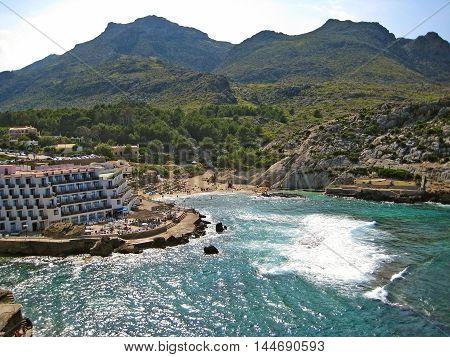 Cala Sant Vicenc Majorca Spain - June 28 2008: Panorama view of Bay Cala Clara / Cala Barques - Hotel Hoposa Niu - mediterranean sea ocean and mountain crest