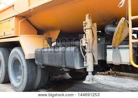 The hydraulic outrigger stabilizers on the truck