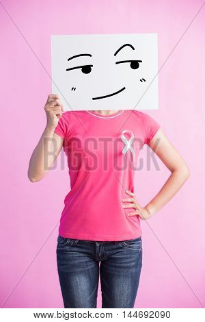 Happy Woman with pink ribbon look something and billboard great for prevention breast cancer concept