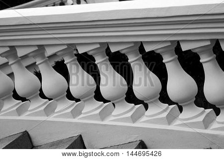 Vintage photo of plaster balustrade balusters, black and white photo