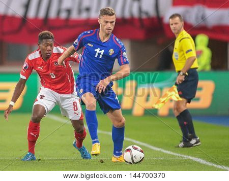 VIENNA, AUSTRIA - SEPTEMBER 5, 2015: David Alaba (Austria) and Nicolae Milinceanu (Moldavia) fight for the ball in an European Championship qualification game.