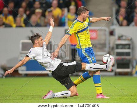 STOCKHOLM, SWEDEN - SEPTEMBER 8, 2015: Aleksandar Dragovic (Austria) and Marcus Berg (Sweden) fight for the ball in an European Championship qualification game.