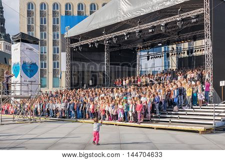 TALLINN ESTONIA - AUGUST 19 2016: Day of Restoration of Independence. Big choir singing anthem of Estonia on Freedom square