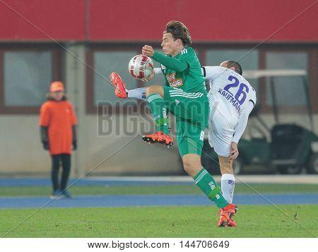 VIENNA, AUSTRIA - OCTOBER 28, 2015: Stefan Schwab (SCR) and Leonard Kaufmann (SBG) fight for the ball in an Austrian Football Cup game.