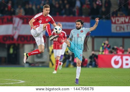 VIENNA, AUSTRIA - MARCH 29, 2016: Lukas Hinterseer (Austria) und Selcuk Inan (Turkey) fight for the ball in a friendly football game.