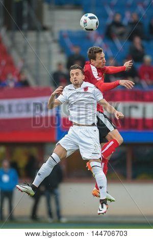 VIENNA, AUSTRIA - MARCH 26, 2016: Emir Lenjani (Albania) und Florian Klein (Austria) fight for the ball in a friendly football game.