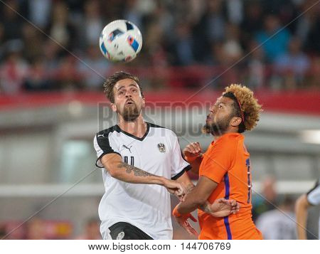 VIENNA, AUSTRIA - JUNE 4, 2016: Martin Harnik (Austria) and Tonny Vilhena (Netherlands) fight for the ball in a friendly football game.