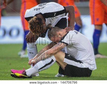 VIENNA, AUSTRIA - JUNE 4, 2016: David Alaba (Austria) comforts Marko Arnautovic (Austria) in a friendly football game.