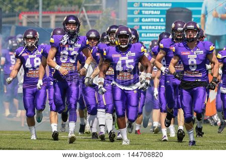 VIENNA, AUSTRIA - MAY 22, 2016: The team of the Vienna Vikings run on the field before a game of the Austrian Football League.