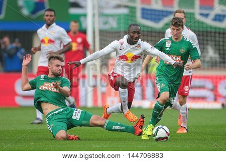 VIENNA, AUSTRIA - OCTOBER 4, 2015: Phillipp Prosenik (SK Rapid) and Naby Keita (RB Salzburg) fight for the ball in an Austrian Football League game.