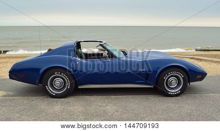 FELIXSTOWE, SUFFOLK, ENGLAND - AUGUST 27, 2016: Classic Blue  Corvette Sports Car on seafront promenade.