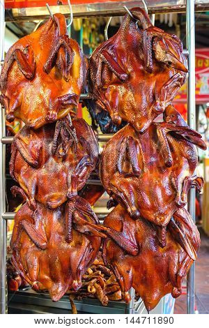 Peking duck roasted for sale at market in Thailand. Traditional chinese cuisine.