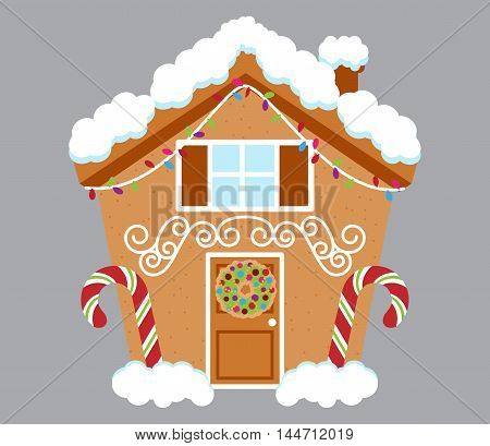 Cute Gingerbread House Covered in Snow and Decorated with Candy and Icing