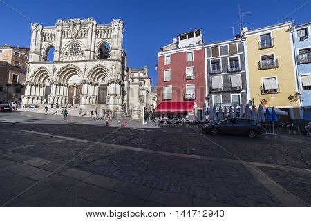 CUENCA SPAIN - August 24,2016: Tourists walk near the facade of the Cuenca's Cathedral The cathedral is dedicated to St Julian gothic english-norman style XII century called the Basilica of Our Lady of Grace, Cuenca, Spain