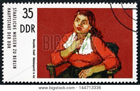 GERMANY - CIRCA 1974: a stamp printed in Germany shows Girl in Red Painting by Rudolf Bergander circa 1974