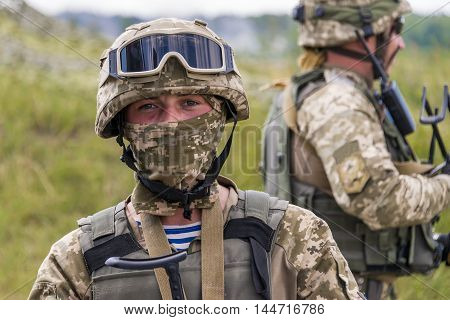 Lviv Ukraine - July 6 2016: Ukrainian-American joint military exercises near the Lviv rapid trident 2016. Ukrainian commando rests after training fight Lviv.Ukraine.