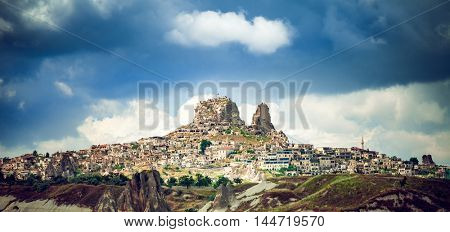 Ancient town and castle of Uchisar dug mountains, Cappadocia, Turkey