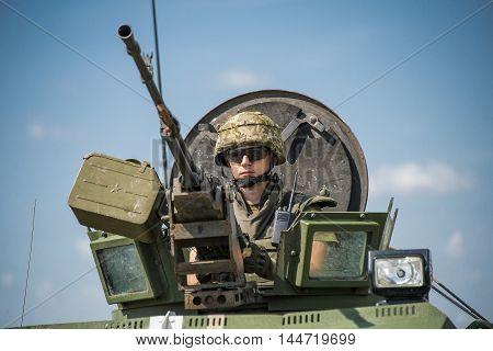 Lviv Ukraine - July 6 2016: Ukrainian-American joint military exercises near the Lviv rapid trident 2016. Gunner prepares to shoot a machine gun NSVT 12.7 on simulated enemy positions Lviv.Ukraine.