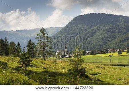 Sankt Ulrich am Pillersee with Jakobskreuz on the Buchensteinwand summit in Kitzbuhel Alps
