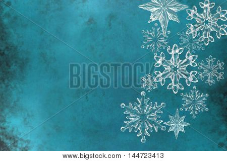 Christmas snowflakes on blue textured background ,