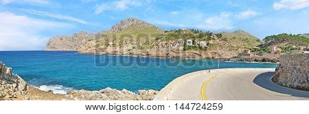 Curve panorama - bay Cala Molins in Cala Sant Vicenc Majorca Spain - mountains with ocean view
