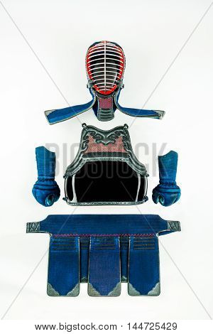 Kendo - Kendoka armor and equipment arranged and displayed on white background.